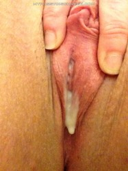 Discharge dripping from spread pussy